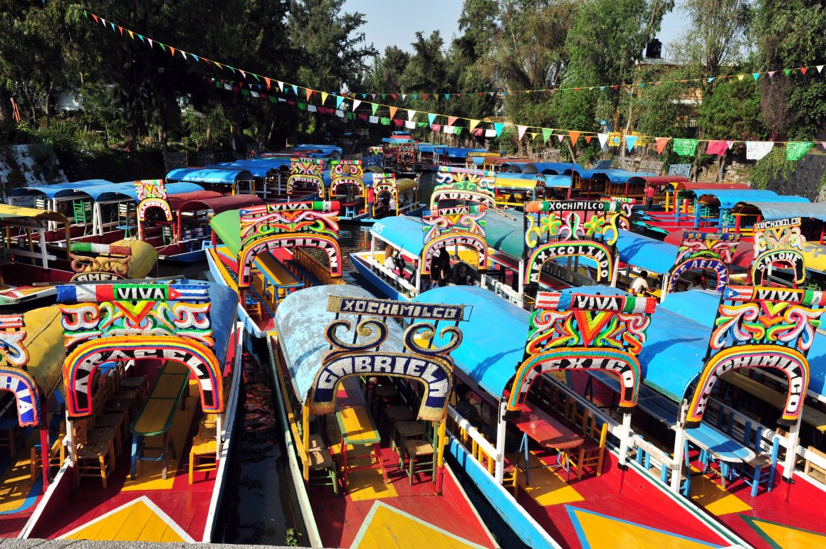 Brightly painted trajinera boats in a canal