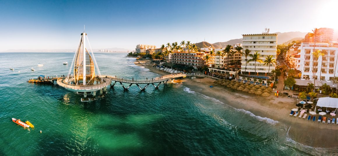 A sailboat-shaped pier connects to the Malecon boardwalk in Puerto Vallarta.